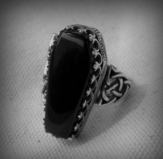 Totally would love to have this coffin ring!!