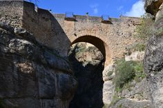 The Old Bridge - Ronda, Spain. You have to walk all the way down into the valley to see this. A great walk. Not to be confused with the grander and taller new bridge.
