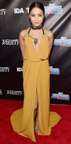 Vanessa Hudgens went boho-chic for the 2015 Industry Dance Awards in a plunge-neck mustard Galia Lahav gown with leather straps and gilded accents. Wooden bangles, rings by Le Vian and Djula, a metallic Oroton clutch, and metallic Kurt Geiger London pumps completed her look.