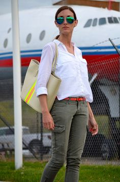 Inspiration: Day Trip - Olive Skinny Pants or Cargos + Orange Belt + White Tee or Button-Down Shirt + Stripe (Gap or Tommy Hilfiger?) Bag or Tote.
