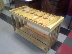 A coffee table created out of a recycled glass door and a pallet.