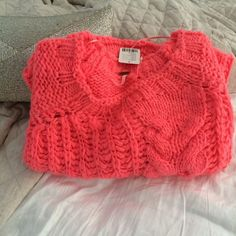 NWT Free People Chunky Cable Knit Sweater Chunky cozy bright orange sweater. So beautiful. I just bought it to wear over a dress, but never wore it. It's super soft. Amazing color: bright melon. Looks stunning with mint green. Free People Sweaters