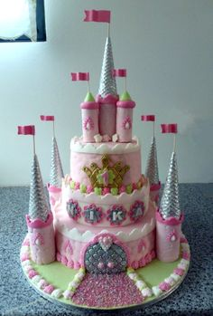 Rabbit princess castle - Birthday cake for 1yr old girl (born in 2011 - Year of the Rabbit). Her mother asked to include something regarding her husband - professional basketball player but still wanted princess castle look. There are 3 rabbits playing basketball on the back. I originally wanted to make castle with rabbits everywhere but was not allowed to :-)) . Bottom tier chocolate cake with white and milk chocolate ganache and chocolate IMBC, middle tier hazelnut cake with Nutella IMBC…