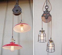Edison filament bulbs with vintage farm pulleys. nice!