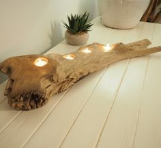 These new wooden tea light holders have a striking nautical style! Not only do these impressive chunks of wood hold four tealight holders which have been beautifully engraved into the rustic wood, we also like to think of these as unique ornaments for the home. Imagine using these to create a focal point on your dining table, hallway or bedroom. Does not include candles.