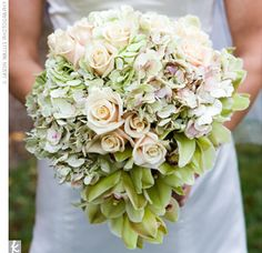 Mary Paige's bouquet was made up of hand-tied, antique hydrangeas, Sahara roses, and green cymbidium