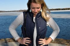 Spring outfit accents - polkadot navy vest, grey sweater, turquoise earrings