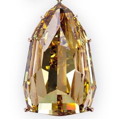 This 407.48-carat Fancy Deep brownish yellow shield step-cut diamond, which is the largest internally flawless diamond ever graded by GIA, is the centerpiece of the L'Incomparable diamond necklace.