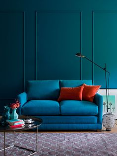 The Aissa Sofabed starts as a two-seat sofa shown here but then opens up into a comfy double bed for your guests. This sofabed is in Marine brushed Linen cotton, a lovely blue-green durable fabric.