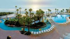 A visual tour of the best resort pools in Central Florida. Pictured is the Ocean Walk pool area in Daytona Beach.
