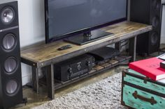 Made-to-order industrial chic television stand designed by Brooklyn Reclamation and made of  reclaimed bowling alley and recycled steel.