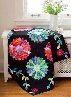 Kaffe's Garden at Night Pattern - Create a strong wow factor by placing bright and modern-print Dresden Plates into a traditional setting. A delightful appliqué border frames the quilt center. This is a Fat Quarter Friendly Project.