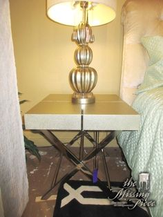 """Contemporary style end table in a brushed silver with chrome accents on crossed chrome legs. Sleek, cleans lines! At posting, we have a pair and the matching cocktail and console tables. 23""""wide x 25""""deep x 23""""high. Arrived: Friday December 9th, 2016"""