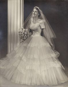 vintage bridal gown from the 1950s. Look at that tiny waist!