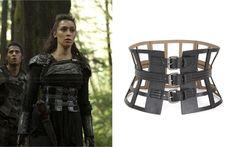"Lexa (Alycia Debnam Carey) wears a BCBGMAXAZRIA Grid Cutout Corset Waist Belt in the color Black in The 100 Season 2 Episode 10 ""Survival of the Fittest."""
