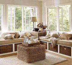 Window seats, you could easily add bookcases to either side to create an awesome window wall