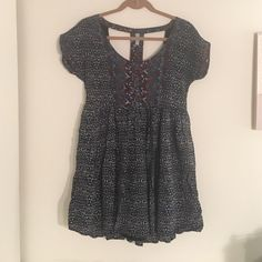 Geometric printed Free People dress Short sleeves with small fold on edges, 3 buttons up front, geometric print all over, cut out in back, loose fitting, flowy dress. Free People Dresses Mini
