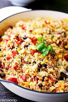 Fiesta Rice Recipe - Mexican inspired side dish recipe with fluffy, tender, flavorful rice and colorful veggies. Serve with Mexican food like, tacos or enchiladas, but it's just as good served with steak or chicken.