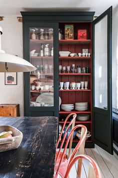 Farmhouse kitchen with a black cabinet made out of antique French doors with a painted red interior. Might have to pain my cabinet like this. Sweet Home, My Ideal Home, Red Interiors, Vintage Interiors, Vintage Home Decor, Vintage Homes, Painted Furniture, Antique Furniture, Antique Hutch