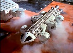 Eagle with lab pod >>> I always loved the Space 1999 tech. It had a very unique look, not as polished as subsequent sci-fi. Cosmos 1999, Sci Fi Tv Shows, Spaceship Design, Sci Fi Ships, Catacombs, Lost In Space, Science Fiction Art, Interstellar, Space Station