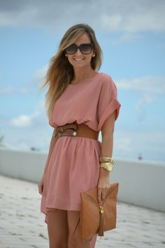 pink dress with brown belt and bag