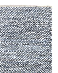 """30 x 120""""  :  Beautiful pieces of recycled denim are woven with leather in a subtle herringbone pattern. The result: A striking design in tonal blues, created entirely by hand. Due to the variance in denim, no two pieces will look quite alike. Finished with cotton binding on either end."""