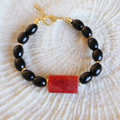 Coral beaded bracelet with shiny black gemstones red by CharmByIA