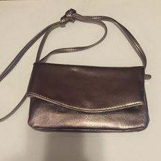 Cute NWOT Metallic Mini Handbag❤️ Cute handbag! NWOT-shiny metallic pewter shade-gorgeous color! 27 inch long strap, measures 8x5 inches. Snap closure, two internal zippered pockets. Bags