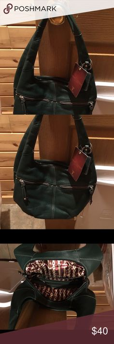 Leather hobo bag. It's real leather,brand new. Lots of pockets, 2 on each side the bag and some others inside the bag. Tignanello Bags Hobos