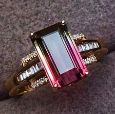 An exquisite and 4.0carat emerald cut watermelon tourmaline gemstone is surrounded by Natural South Africa Diamonds in this brilliant 18k gold ring. Main stone: Natural watermelon tourmaline Carat wei