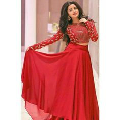 Exclusive crop top and georgette lehenga. Beautiful embroidered red coloured georgette crop top with matching lehenga. Look beautiful by wearing this stylist designer lehenga. Long Gown Dress, Lehnga Dress, The Dress, New Long Dress, Frock Dress, Lehenga Choli Designs, Red Lehenga, Party Wear Lehenga, Red Crop Top