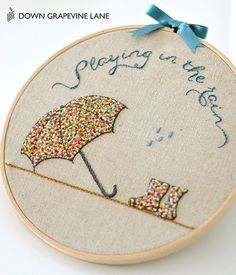 Playing in the Rain sprinkles embroidery by Down Grapevine Lane. Sprinkled umbrella and rain boots, made with French knots. There are so many different stitch options when it comes to hand embroidery and the French knot is a stunning, yet easy one to mast French Knot Embroidery, Embroidery Hoop Crafts, Embroidery Art, Embroidery Applique, Cross Stitch Embroidery, Embroidery Patterns, Machine Embroidery, Art Patterns, Japanese Embroidery