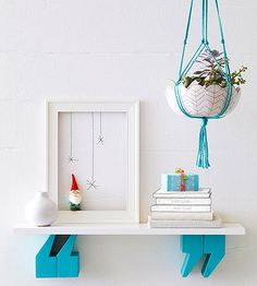 Quote Shelf - actually, it's the gnome on the frame with the snowflakes that got me! from bhg
