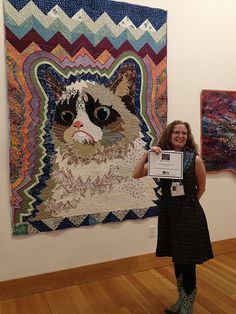 Kristin La Flamme and her Grumpy Cat quilt. Best of Show, Art Quilt Elements 2014.