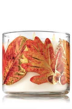 """Chestnut & Clove - 3-Wick Candle - Bath & Body Works - The Perfect 3-Wick Candle! Made using the highest concentration of fragrance oils, an exclusive blend of vegetable wax and wicks that won't burn out, our candles melt consistently & evenly, radiating enough fragrance to fill an entire room. Decorated with beautiful leaves & topped with a flame-extinguishing lid! Burns approximately 25 - 45 hours and measures 4"""" wide x 3 1/2"""" tall."""