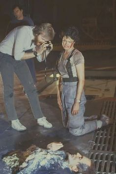James Cameron and Sigourney Weaver with Lance Henriksen on the set of Aliens