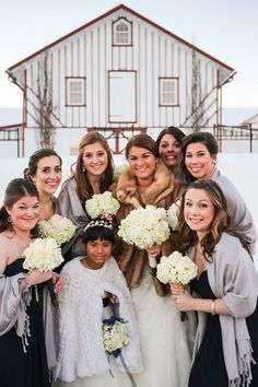 Give bridesmaids Pashminas to keep them warm for outdoor pictures at your winter wedding | Brides.com