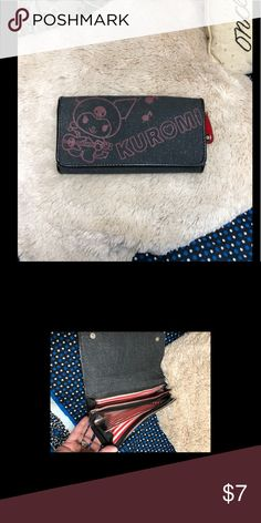 Sanrio Kuromi Guitar Player Wallet Sanrio Kuromi Guitar Player Wallet   This is a used item and may show signs of ❤️ such as loose strings, tears, pilling, wearing and stains. Please review all photos 😀   COMES FROM A DOG AND SMOKE FRIENDLY HOME. Sanrio Kuromi Bags Wallets