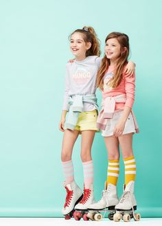 Cool summery kids photoshoot. Shorts, tshirts and roller boots with pulled up socks