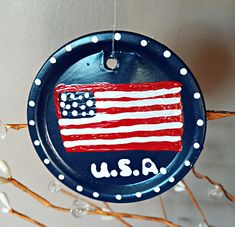 Kid's Crafts - Painted Patriotic USA Flag Mason Jar Lid Ornaments Craft Projects For Kids, Arts And Crafts Projects, Peg Hooks, White Paint Pen, Acrylic Paint Pens, Mason Jar Lids, Usa Flag, Classy, Ornaments