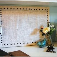 Covering cork board, thick cardboard or foam board with burlap makes a nifty bulletin board board! Bonus for framing in an old frame! Great for jewelry!