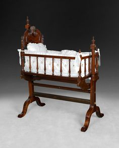 Beautiful Regency Rosewood Crib on Stand on show at Harvey's Antiques in Witney.