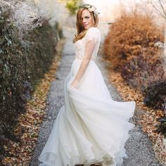 modest wedding dress flowy skirt and lace sleeves