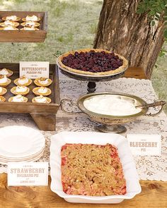 Eunice and Dan's dessert table boasted signage that matched their invitation suite and a variety of serving pieces.