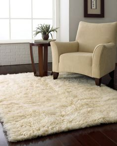 round shag rug in nook upstairs with comfy reading chair and little table