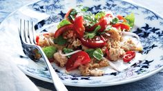 An easy skillet dinner that takes everyday ground turkey and rice to a flavorful new level with Thai accents of lime juice, garlic, ginger, and coconut milk. It's topped with a simple salad of basil, cilantro, and tomatoes for color and freshness.