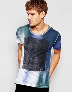 Imagen 1 de Camiseta blanca con cuello redondo y estampado efecto espray con recuadro de Replay