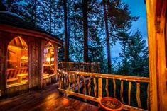 """Suzanne Dege's """"Hobbit Treehouse."""" Originally built by the legendary natural builder, SunRay Kelley. Located on Orcas Island in Washington State. The three circular pods are all connected by hallways,. Forest Cabin, Forest House, Tree Forest, Stairway To Heaven, Cabana, 1 Bedroom House, Unique Vacations, Beach Vacations, Orcas Island"""