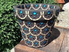 Loving the blue stones and pink stones catching the sun on this planter!  https://www.etsy.com/listing/153857657/mosaic-flower-pot-planter-popular