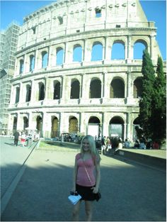 Caitlin Sullivan of It Girl Weddings in front of the Colosseum in Rome http://www.itgirlweddings.com/wifestyle/roaming-the-streets-of-rome